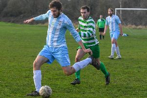 Armley Sundays FC's Callum Buther gets the ball rolling against visiting East Leeds Celtic. PIC: James Hardisty