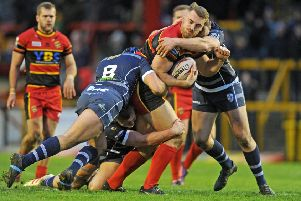 Dewsbury Rams' Tom Garratt in action against Featherstone Rovers last week.  Picture Tony Johnson.
