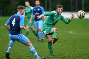 HT Sports' Joe Hill looks on as New Pudsey's Luke Kitson sets off an attack during Sunday's Leeds Combination League Jubilee Premier encounter. PIC: Jonathan Gawthorpe