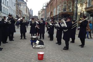MUSIC: A Salvation Army brass band pipes up in Leeds city centre.