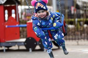 Opening of the new playground at Roundhay Park. Eloise White tries out one of the new swings.