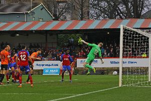 Chesterfield's Will Evans heads them in front against his former side Aldershot.