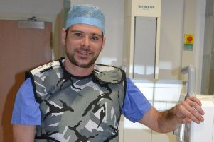 Diagnostic radiologist Adam Wallwork is in training to run the London Marathon wearing a lead vest weighing a stone.