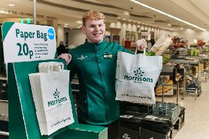 """Pictures to show how Morrisons is giving customers the option of using large paper carrier bags in eight of its stores from this week. The trial is a response to customers who have told Morrisons reducing plastic is their number one environmental concern. The new US-style paper grocery bags have handles and are a similar capacity to standard plastic carrier bags.  They are 100% PEFC accredited meaning they are sourced from forests that are managed responsibly.  ''Priced at 20p each the paper grocery bags, which can be reused and ultimately recycled, are labelled 'Reusable Paper Bag'. As part of the trial, Morrisons is also increasing the price of standard plastic carrier bags from 10p to 15p to further reduce plastic use. This follows Morrisons�"""" removal of the 5p carrier bags early in 2018 which led to 25% reduction in overall bag sales.  This 15p standard plastic carrier bag is produced in the UK and is made from recycled material reclaimed from Morrisons stores. ''For more information, please contact the"""