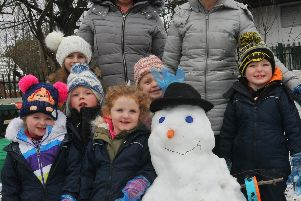 Kids at Leigh South Community Nursery have fun no matter what the weather is like.