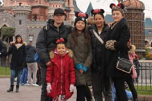 Vicki  Aldwin (right) with family on a trip to Disneyland Paris
