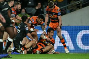 Castleford Tiger's Jesse Sene-Lefao (floor) celebrates scoring his sides second try at Hull. Picture: Richard Sellers/PA