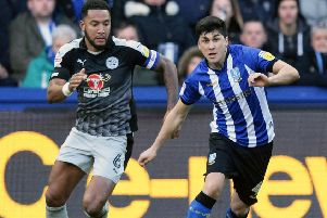 On the attack: Fernando Forestieri gets away from Reading's Liam Moore. Picture: Steve Ellis