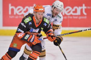 IN THE FIGHT: Sheffield Steelers' Ben O'Connor battles for possession against Nottingham on Saturday night. Picture: Dean Woolley.