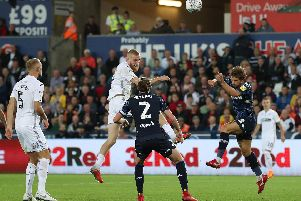 DANGER MAN: Swansea City's Ollie McBurnie scores in the 2-2 draw at Swansea City back in August.