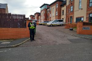 The entrance to the Redcourt apartments in Athlone Grove remains sealed off by police.
