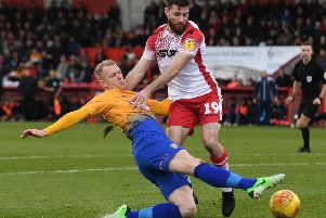 Mansfield's Neal Bishop battles with Stevenage's Danny Newton