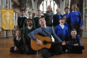 The Lake Poets Marty Longstaff with youngsters from Grangetown Primary and Hudson Road at Sunderland Minster, along with Janet Nettleton