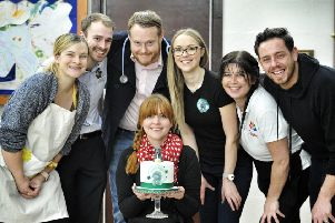 Lucy Gillhespy , centre, with the birthday cake, pictured with some of the supporters