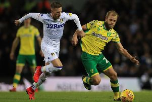 UP TOGETHER?: Leeds United's Barry Douglas and Norwich City's Teemu Pukki lock horns in this month's clash at Elland Road. The two sides have the best run-ins of the top seven on paper and will occupy the top two positions if Leeds win their game in hand.