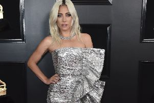 METALLICS (and exaggerated ruffles). Lady Gaga - nominated in the Oscars Best Actress category - stepped out for the Grammys wearing a metallic strapless side ruffle gown by Celine by Hedi Slimane, teamed with Jimmy Choo shoes and Tiffany & Co jewellery. On her it works, not least because she keeps accessories, hair and make-up unusually low-key. But then, this lady has never been afraid of a big dress. Picture: Jordan Strauss/Invision/AP)