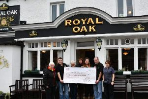 Staff at the Royal Oak in Nidderdale present the funds to Lin Stead, North Regional Fundraiser for the Yorkshire Air Ambulance