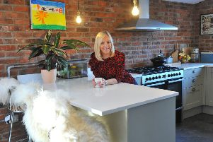 Lyndsey in the kitchen area. The units are from Howdens and the worktops are Corian.