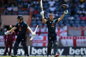 Jos Buttler of England celebrates reaching his century with captain Eoin Morgan.    (Photo by Gareth Copley/Getty Images)