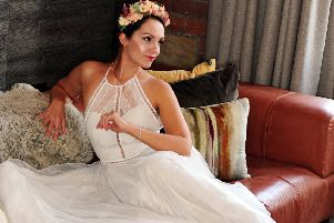 Polina wears halterneck bridal gown, �1,050, and floral headdress, �120. Both from The Bridal Emporium, Grand Arcade, Leeds. ''Location: The Bells serviced apartments, Church Row, Leeds. Picture by Simon Hulme