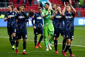 Leeds United's players celebrate following full-time at Ashton Gate.
