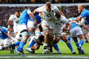 England's Jamie George (bottom) scores his side's first try.