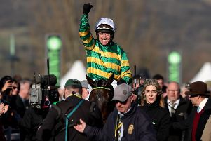 Buveur D'Air is led in by Hannah Ryan after winning last year's Champion Hurdle under Barry Geraghty.