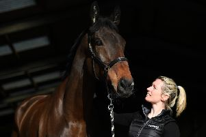 Trainer Kayley Woollacott with her Arkle hopeful Lalor who was acquired by her late husband Richard.