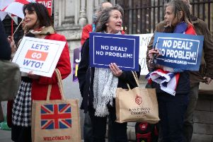 Protesters outside Parliament before today's Brexit vote.