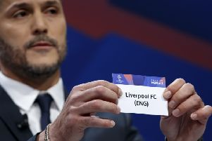 Former Brazilian soccer player Julio Cesar, ambassador for the UEFA Champions League, shows a ticket of England's club FC Liverpool, during the drawing of the matches for the Champions League 2018/19 quarter-finals at the UEFA headquarters in Nyon. (Salvatore Di Nolfi/Keystone via AP)