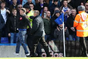 "The fan who attacked Aston Villa's Jack Grealish is escorted off the pitch during the Sky Bet Championship match at St Andrew's Trillion Trophy Stadium, Birmingham. PRESS ASSOCIATION Photo. Picture date: Sunday March 10, 2019. See PA story SOCCER Birmingham. Photo credit should read: Nick Potts/PA Wire. RESTRICTIONS: EDITORIAL USE ONLY No use with unauthorised audio, video, data, fixture lists, club/league logos or ""live"" services. Online in-match use limited to 120 images, no video emulation. No use in betting, games or single club/league/player publications."