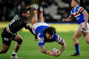 Wakefield's David Fifita is upended by Hull's Albert Kelly (PIC: Dean Williams)