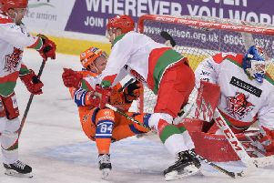 TAKE THAT: Sheffield Steelers' Tom Zanoski is taken to the ice by a Cardiff defender in January's meeting between the two at Sheffield Arena. Picture: Dean Woolley.