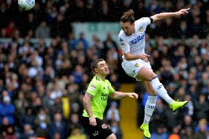Leeds United's Luke Ayling challenges Sheffield United's John Fleck at Elland Road.