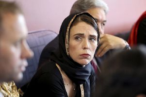 In this photo released by New Zealand Prime Minister's Office, Prime Minister Jacinda Ardern, meets representatives of the Muslim community.