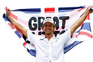 Champion: Brawn GP's Jenson Button celebrating after clinching the crown in Brazil in 2009.