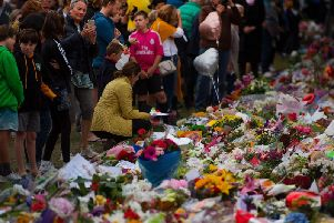 People pay their respects at a memorial site at the Botanical garden in Christchurch three days after a shooting incident at two mosques in the city that claimed the lives of 50 Muslim worshippers. Photo: Getty