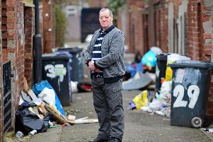 Steve Parsons, pictured, has had enough of the persistent fly-tipping in the backs between Ellerker Avenue and Stone Close Avenue, Hexthorpe. Picture: NDFP-19-03-19-Flytipping-8
