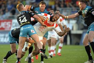 CLOSING IN: Leeds Rhinos get to grips with Catalans new signing Sam Kasiano. Picture: Pascal Rodriguez