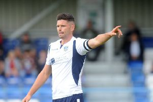Guiseley's 'Scott Garner came close to equalising at Hereford.