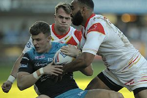 BOUNCING BACK: Ash Handley is taken down by the Catalans defence. Picture: Pascal Rodriguez/RLPhotos.com