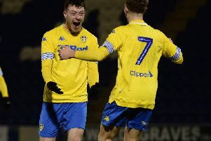 Leeds United striker Ryan Edmondson celebrates his opening goal at Colchester.