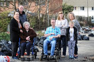 Concerned residents pictured on the site of the former Benbow pub, which has now turned into a fly-tipping hot spot. Picture: Marie Caley/Doncaster Free Press
