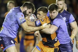 Alex Walmsley and Mark Percival get to grip[s with Castleford's Greg Eden last week. Picture: SWPix