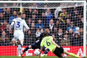 Sheffield United's Chris Basham drives home a second-half chance to inflict a 1-0 defeat on Leeds United at Elland Road.