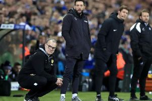Carlos Corberan, centre, on the touchline with Marcelo Bielsa during Leeds United's win over Swansea City in February.