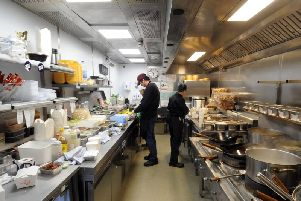 Chefs at work in one of the kitchen units at the Deliveroo Editions site in Leeds.