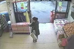 CCTV captures an unidentified accomplice snapping a picture of the misplaced juice box before Ashraf (left) turned and feigned tripping over it.