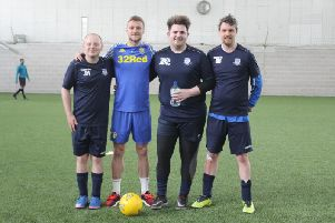 Leeds United captain Liam Cooper with members of the disability team.