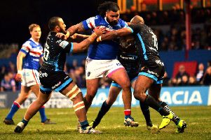 David Fifita takes on Huddersfield's Suaia Matagi and Michael Larence.
